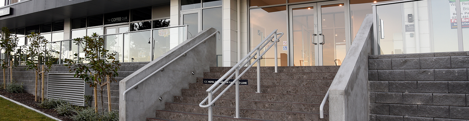 Powdercoated handrail up entrance stairs to Ramada Albany